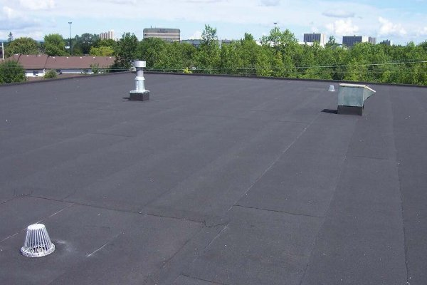 "One of the most popular roofing system in North America, Modified Bitumen roofing is an asphalt-based product used on buildings with low-slope or ""flat"" roofs. They are installed by welding, hot asphalt, and adhesives. These roofs have long warranties, great waterproofing, and can be used with energy efficient reflective top surfaces."