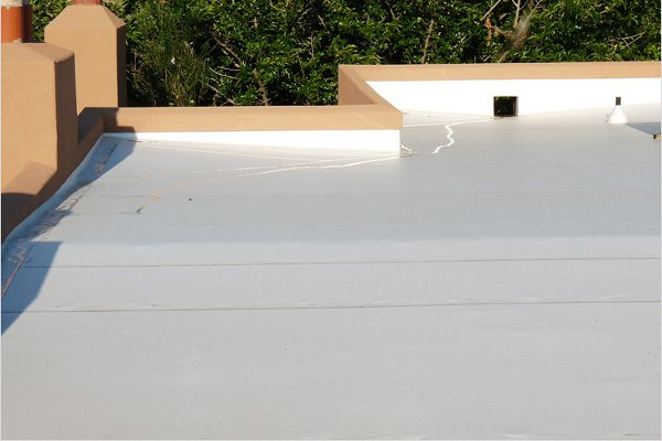 Single-ply membranes are factory-manufactured sheet membranes. Often thought of as commercial roofing, they can be a durable and cost effective residential roof as well. Single-ply membranes can be installed fully adhered, mechanically attached or held down with ballast. Most single-ply roof systems do not receive surfacings, as the membrane itself is designed to withstand the elements.
